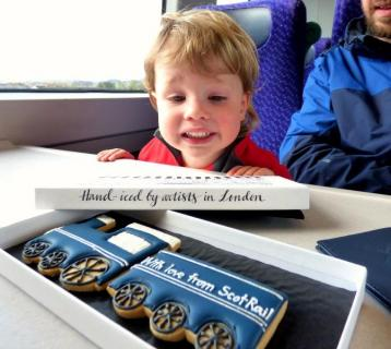 Jenny Eaves' son on train with ScotRail biscuit