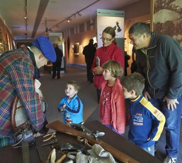 Family visiting Culloden Battlefield Visitor Centre