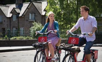 Man and woman on Bike & Go bicycles