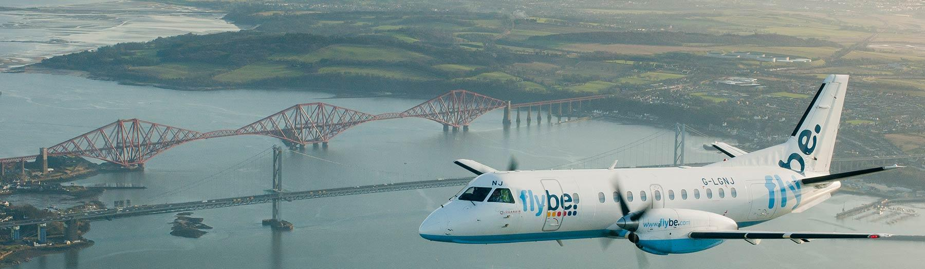 Flybe plane flying over Forth Bridge