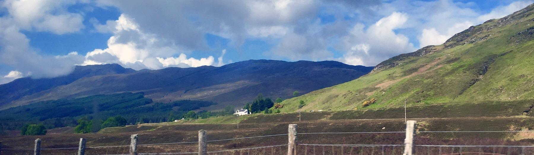 View of a house in the Highlands from the train on the Kyle Line