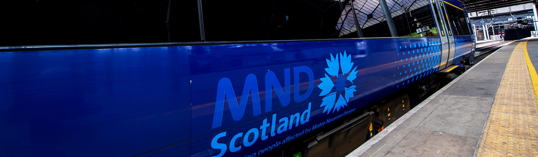 ScotRail train with MND Scotland logo