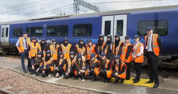 <p>Pupils from Bellahouston Academy at Shields Depot with ScotRail Alliance Engineering Director, Angus Thom</p>
