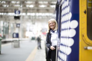 News: Smiling Staff at Station