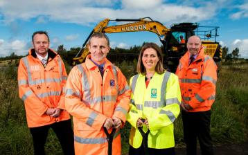<p>Scotrail Chief Operating Officer Angus Thom; Cabinet Secretary for Transport, Infrastructure and Connectivity Michael Matheson; Councillor Anna Richardson, City Convener for Sustainability and Carbon Reduction at Glasgow City Council; and Alan Ross, Director Route Sponsorship for Network Rail Scotland standing in front of a JCB at the site of the new Robroyston railway station</p>