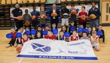 <p>ScotRail Sustainability and Safety Assurance Director David Lister is pictured with a large group of young people, and basketballscotland representatives at a launch event in Paisley Lagoon Centre.</p>