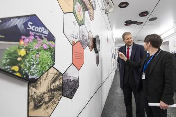 ScotRail Alliance managing direct, Phil Verster, and lead artist of WAVEparticle, Peter McCaughey inspect the new artwork in the newly refurbished Kilmarnock station underpass.
