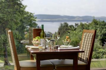 Dining table in window with scenic view