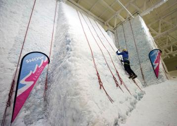 Climbing the ice wall at Snow Factor