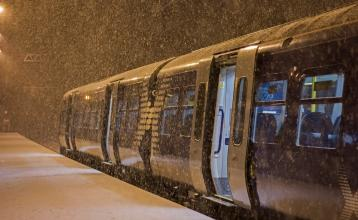Snow falling on a ScotRail train at Livingston North station